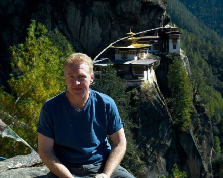 Your host in the land of Gross National Happiness--Bhutan.